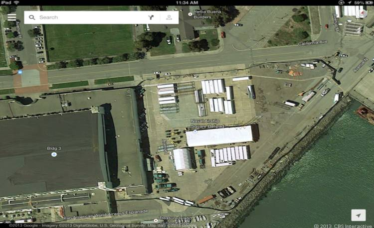 Sometime after Hangar 3 was occupied, the building and much of the adjacent area was cordoned off behind security fencing, ensuring that no one could see in. (Credit: Screenshot by CNET)